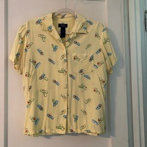 Yellow blouse with flip flops